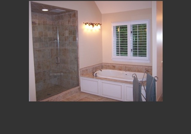 Bath 1-Whirlpool tub & tile shower w/ frameless glass doors